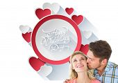 Handsome man kissing girlfriend on cheek against happy valentines day