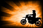 motorcyclist on the abstract background