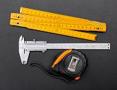 foto of calipers  - Measuring tools on black background - JPG