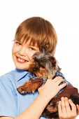 Yorkshire Terrier in pullover with smiling boy