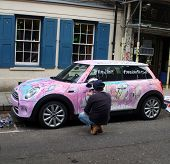 Artist painting a car