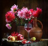 Apples, A Pomegranate And Pink Wine And A Bouquet A Dahlia
