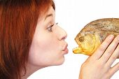 Girl kissing piranha