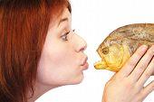 Girl kissing piranha
