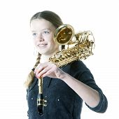 Blond Teenage Girl Holds Saxophone In Studio