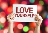 Love Yourself card with colorful background with defocused lights