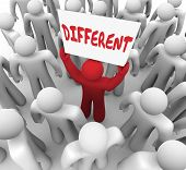 picture of divergent  - Different word written on a sign held by a red man in a crowd to illustrate someone who is unique - JPG