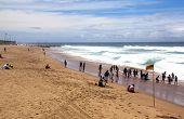 Visitors Enjoy A Sunny Day At Brighton Beach