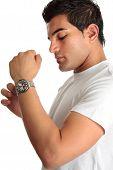 Man Putting On Chronograph Watch
