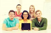 education, technology and college concept - five smiling students showing tablet pc computer blank screen at school