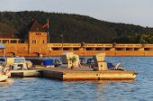 stock photo of dam  - masonry dam of the edersee from the waterside at the sunset - JPG