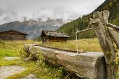 Wooden fountain in the alps