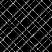Grungy tartan background for decoration or backdrop. Endless vector.