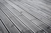 stock photo of naturel  - wet wood terrace floor as a background texture - JPG