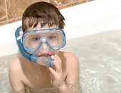 The Boy Diving Into A Bathroom In A Mask And A Tube For Diving