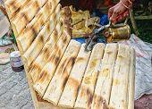 Spraying Colour On Cane Chair, Indian Handicrafts Fair