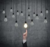 Hand Pointing To Light Bulbs