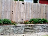 stock photo of stockade  - Wooden privacy fence along street - JPG