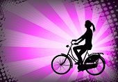 silhouette of female bicyclist on the abstract purple background