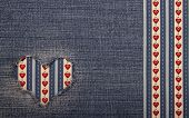 stock photo of applique  - Heart symbol in denim trimmed with other tissue - JPG