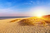 Baltic sea sand dunes over sunset, Baltic coast Poland.