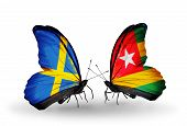 Two Butterflies With Flags On Wings As Symbol Of Relations Sweden And Togo