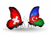 Two Butterflies With Flags On Wings As Symbol Of Relations Switzerland And Azerbaijan