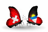 Two Butterflies With Flags On Wings As Symbol Of Relations Switzerland And Antigua And Barbuda
