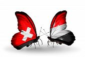 Two Butterflies With Flags On Wings As Symbol Of Relations Switzerland And Yemen