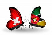 Two Butterflies With Flags On Wings As Symbol Of Relations Switzerland And Mozambique