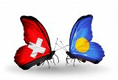 Two Butterflies With Flags On Wings As Symbol Of Relations Switzerland And Palau