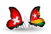 Two Butterflies With Flags On Wings As Symbol Of Relations Switzerland And Togo