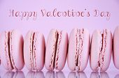 Happy Valentines Day Pink Macaroons On Pink Background With Sample Text Greeting Message.
