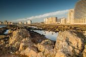 picture of sea-scape  - Rocky beach at Somerset West with a view to the city scape at low tide - JPG