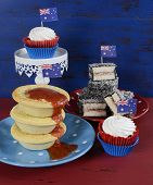 Happy Australia Day January 26 Party Food With Iconic Meat Pies, Lamingtons And Cupcakes On Dark Red