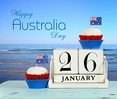Happy Australia Day, January 26, Theme White Wood Vintage Calendar And Red, White And Blue Cupcakes