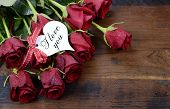 Happy Valentine's Day Red Roses On Dark Recycled Wood Background With I Love You Greeting On Heart S