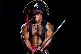 stock photo of pirate sword  - Portrait of a muscular man in a pirate costume - JPG