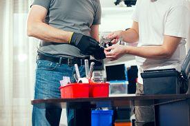 pic of micrometer  - Two man in the workshop - JPG