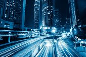 image of skyscrapers  - Futuristic night cityscape view with illuminated skyscrapers and city traffic across street. Hong Kong ** Note: Soft Focus at 100%, best at smaller sizes - JPG
