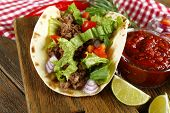 stock photo of mexican food  - Mexican food Taco on wooden cutting board - JPG