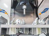 stock photo of machine  - operator machining aluminum automotive parts by machining center - JPG