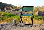 picture of lawn chair  - Camp chair and thermos cup on nature background - JPG