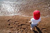 picture of boys  - Cute boy playing and having fun on the beach - JPG