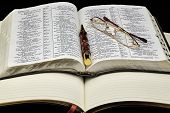 foto of bible verses  - Personal diary journal with bible and Reading Glasses and Business Pen - JPG