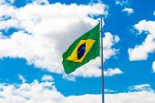 picture of brasilia  - Brazilian waving flag on blue sky - JPG