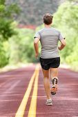 Постер, плакат: Running man runner working out for fitness Male athlete on jogging run wearing sports running shoes