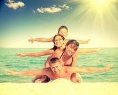 picture of children beach  - Happy Family Having Fun at the Beach - JPG