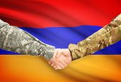 image of armenia  - Soldiers shaking hands with flag on background  - JPG