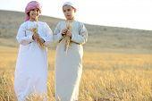 pic of muslim kids  - Kids on wheat field - JPG